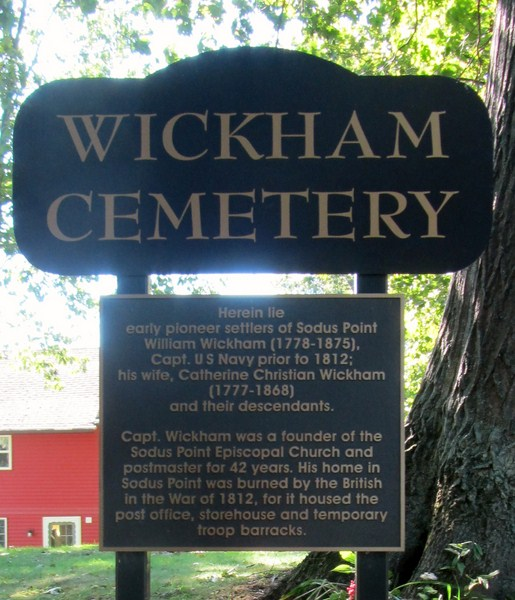 This plaque is located at 8438 Wickham Blvd, Sodus Point on the south side of the street.